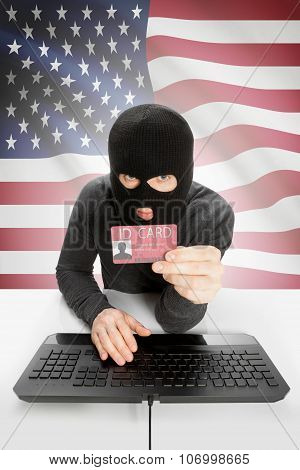 Hacker With Flag On Background Holding Id Card In Hand - United States