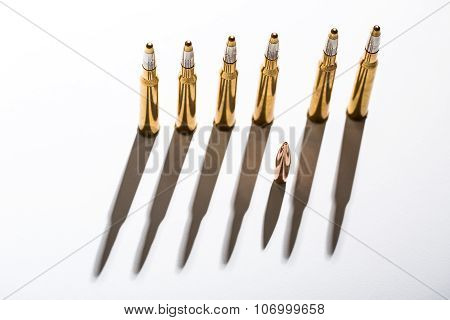 Macro shot of bullet casings on a white studio background