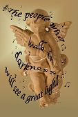 stock photo of glorify  - This is a religious photo of a terrra cotta angel blowing a horn with the words from Isaiah 9 - JPG