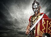 foto of legion  - Picture of a legionary soldier over stormy sky - JPG