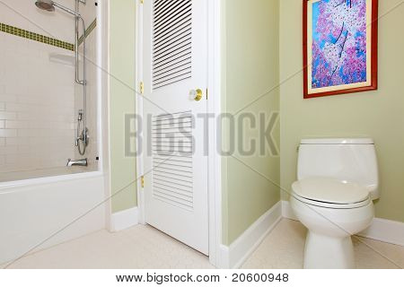 Green Bathroom With Tub And Cherry Painting