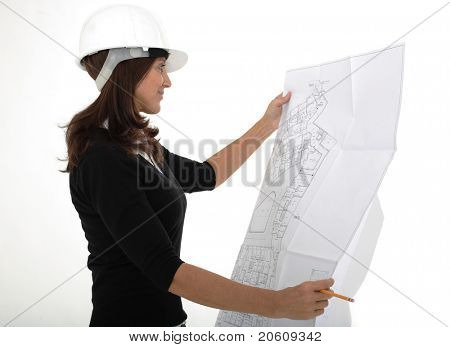 Closeup portrait of a mature female architect holding blueprints isolated on white background