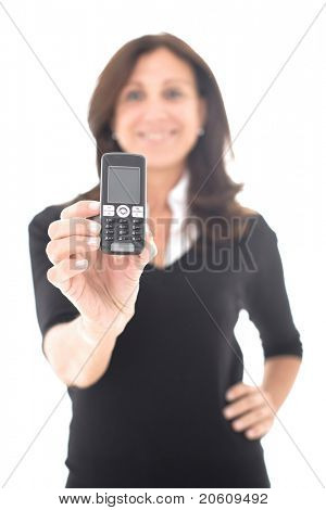 business mature woman showing mobile phone over a white background