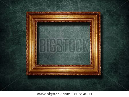 Golden frame over gray vintage wallpaper