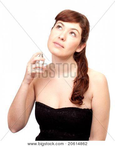 Isolated beauty readhead woman with perfume