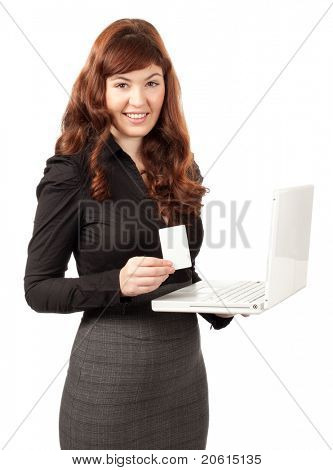 Smiling business woman shopping on-line with credit card and laptop on white background