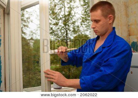 Worker Repairs A Window
