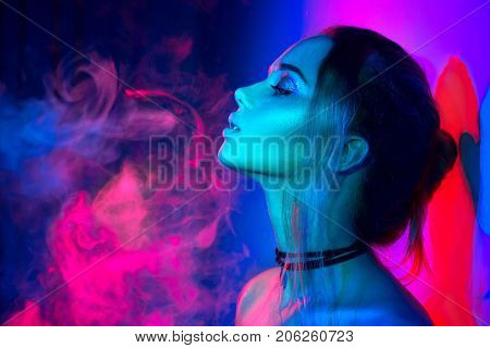poster of High Fashion model woman in colorful bright lights posing, portrait of beautiful  girl with trendy m
