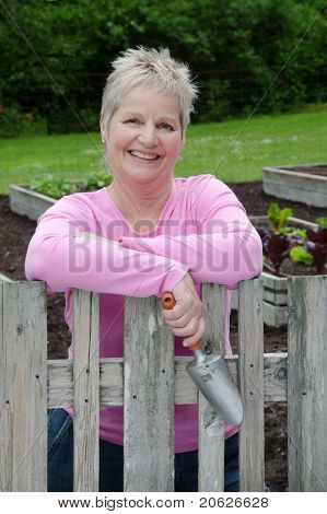 Happy Woman With Trowel