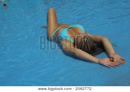 A Young Woman Is Relaxing In A Pool