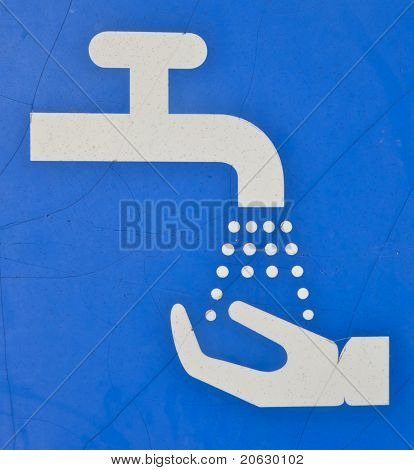 sign recommends hands washing