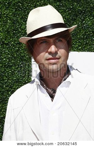 LOS ANGELES - OCT 10:  Rodger Berman arriving at the Veuve Cliquot Polo Classic Los Angeles at Will Rogers Park, Los Angeles, California on October 10,  2010.