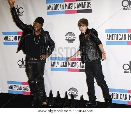 LOS ANGELES, CA - NOV 21:  Usher and Justin Bieber at the 2010 American Music Awards held at the Nokia Theater on November 21, 2010 in Los Angeles, California.