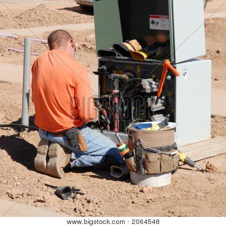 Electrician Working On Breaker Panel