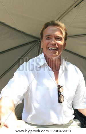 TRABUCO CANYON - OCT 21: Governor Arnold Schwarzenegger meets supporters at a campaign at a biker rally held in support of U.S. troops + their families, in Trabuco Canyon, CA on October 21, 2006.