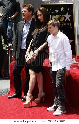 LOS ANGELES - MAY 23: Simon Fuller, Victoria Beckham, Brooklyn Beckham at a ceremony where Simon Fuller receives a star on the Hollywood Walk of Fame in Los Angeles, California on May 23, 2011.