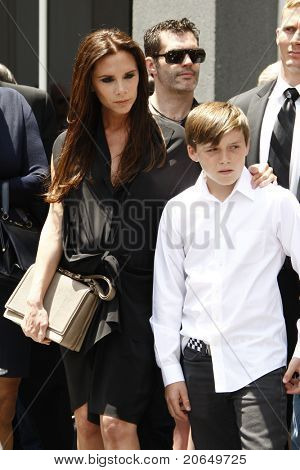 LOS ANGELES - MAY 23: Victoria Beckham, Brooklyn Beckham at a ceremony where Simon Fuller receives a star on the Hollywood Walk of Fame in Los Angeles, California on May 23, 2011.