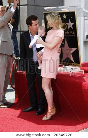 LOS ANGELES - MAY 23: Simon Fuller, wife and daughter at a ceremony where Simon Fuller receives a star on the Hollywood Walk of Fame in Los Angeles, California on May 23, 2011.
