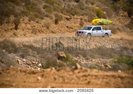 Truck With Kayaks Off-Road