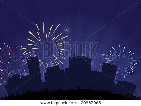 Fireworks over city skyline silhouette