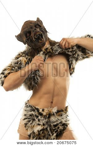 Man in an image of  snarling scary werewolfing  tearing away his pelt