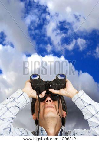 Business Man With Binoculars Over Sky