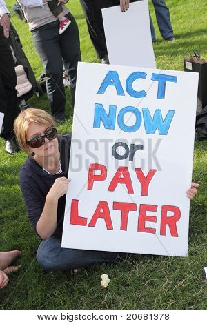 Brisbane, Australia - June 6 : Woman With Act Now Or Pay Later Anti Polution Sign At Say Yes To Carb