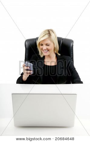 Young Businesswoman At Desk On Cell