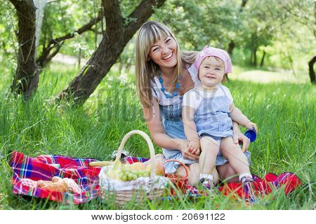 Mother with daughter outdoors