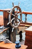 Old boat steering wheel from wood poster