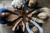 Group of christianity people praying hope together poster