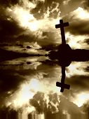 stock photo of christian cross  - Christian cross and the clouds with water reflection - JPG