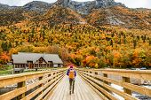 Autumn nature hiker girl walking in national park in Quebec with backpack. Woman tourist going campi poster