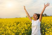 Outdoor portrait in golden evening sunshine of beautiful happy mixed race African American girl teen poster