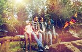 hike, travel, tourism and people concept - happy family sitting on bench and talking at camp near ca poster