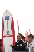 HUNTINGTON BEACH, CA - OCT 6: Arnold Schwarzeneggerwas presented with a surfboard at the CA Comeback