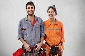 Glad Bearded Handyman And His Female Companion Stand Next To Each Other, Feel Support And Help, Work poster
