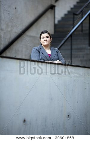 Businesswoman - Looking Over Wall