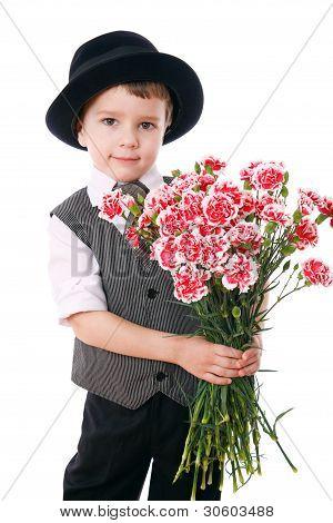 Little boy holds a bouquet of carnations