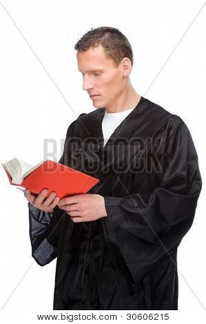 Full isolated studio picture from a young judge (lawyer) with statute book