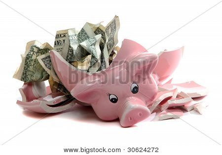 Broken Piggybank With Dollar Notes
