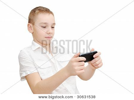 Boy is playing on smartphone