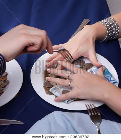 hand with a fork for the money runs