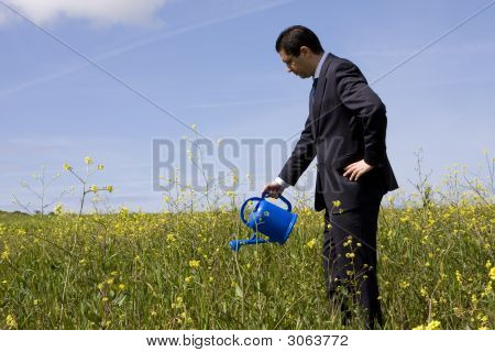 Businessman With A Flowerpot