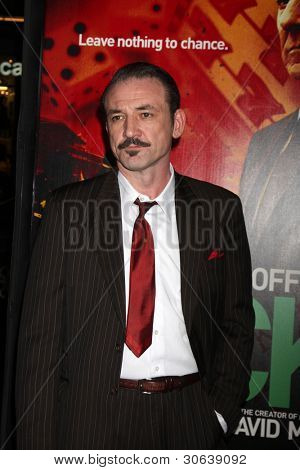 LOS ANGELES - JAN 25:  Ritchie Coster arrives at  the