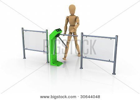 The wooden man in front of an open green turnstile