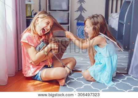 poster of Two Little Mad Angry Girls Sisters Having Fight At Home. Friends Girls Can Not Share Toy Bag. Lifest