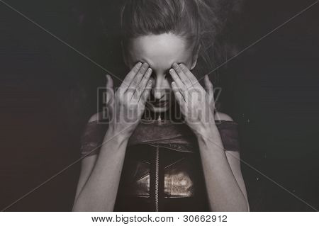 Beautiful Young Woman Covering The Eyes With His Hands