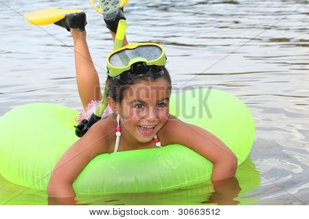 Young girl learning to snorkel