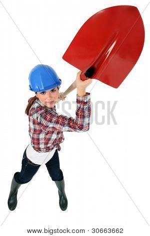 Construction worker wielding a shovel